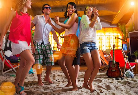 dancing - Friends dancing on sand at indoor beach bar Stock Photo - Premium Royalty-Free, Code: 649-07063541