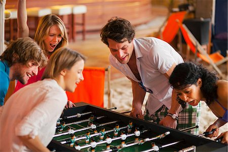 Friends having fun playing table football Stock Photo - Premium Royalty-Free, Code: 649-07063554