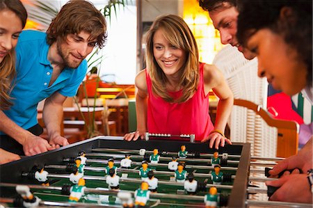 Friends playing table football Stock Photo - Premium Royalty-Free, Code: 649-07063553