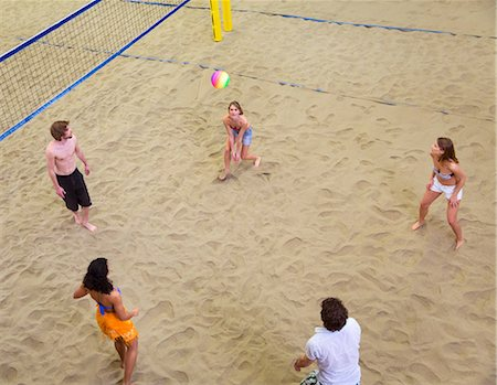 playing - Aerial view of friends playing indoor beach volleyball Stock Photo - Premium Royalty-Free, Code: 649-07063561