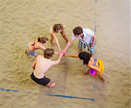 Aerial view of friends team talk at indoor beach volleyball Stock Photo - Premium Royalty-Free, Code: 649-07063562