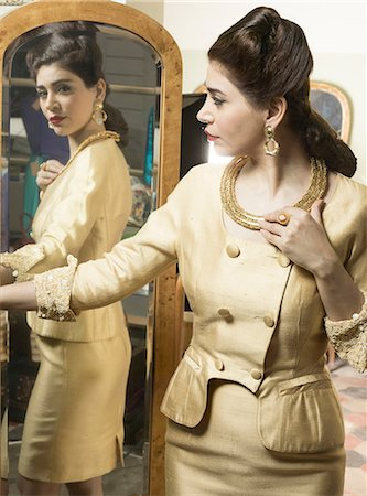 self indulgence - Woman in vintage clothes looking in mirror Stock Photo - Premium Royalty-Free, Code: 649-07063574