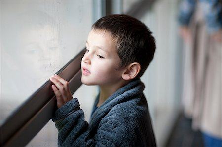 Young boy watching through porch window Stock Photo - Premium Royalty-Free, Code: 649-07063637