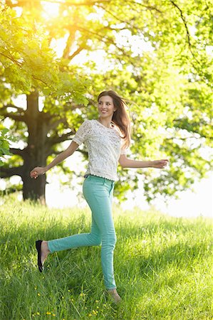 Young woman running through meadow Stock Photo - Premium Royalty-Free, Code: 649-07063658