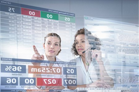 Customer service operators looking at interactive screen Stock Photo - Premium Royalty-Free, Code: 649-07063664
