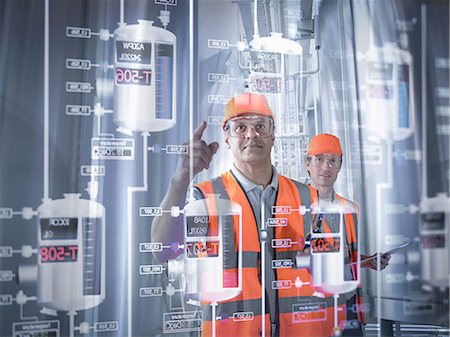 Factory supervisor monitoring product levels on interactive screen Stock Photo - Premium Royalty-Free, Code: 649-07063667