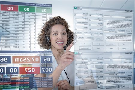 Customer service operator using interactive screen Stock Photo - Premium Royalty-Free, Code: 649-07063663