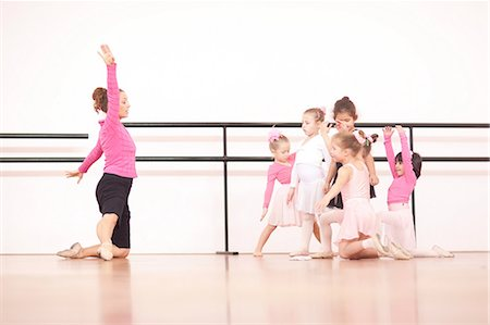 Teacher demonstrating to a group of young ballerinas Stock Photo - Premium Royalty-Free, Code: 649-07063678