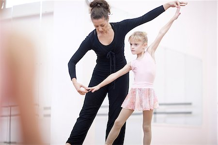 Young ballerina practicing pose with teacher Stock Photo - Premium Royalty-Free, Code: 649-07063685