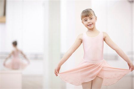 Portrait of a young ballerina holding skirt Stock Photo - Premium Royalty-Free, Code: 649-07063686
