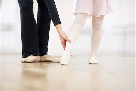 Close up of a young ballerina and teacher practicing toe point Stock Photo - Premium Royalty-Free, Code: 649-07063688