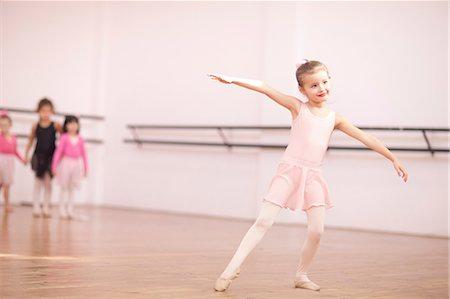 Young ballerina posing in class Stock Photo - Premium Royalty-Free, Code: 649-07063680
