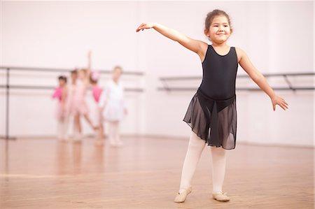 elegant - Young ballerina posing in dance studio Stock Photo - Premium Royalty-Free, Code: 649-07063682
