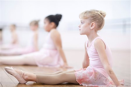 Young ballerinas sitting on floor in pose Stock Photo - Premium Royalty-Free, Code: 649-07063697