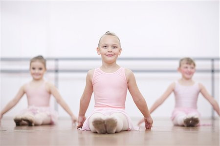 Young ballerinas in pose whilst sitting on floor Stock Photo - Premium Royalty-Free, Code: 649-07063698