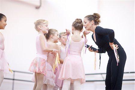 Teacher and enthusiastic young ballerinas Stock Photo - Premium Royalty-Free, Code: 649-07063691