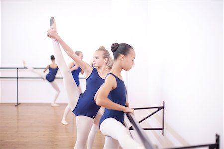 preteen girls stretching - Ballerina warming up at the barre Stock Photo - Premium Royalty-Free, Code: 649-07063707