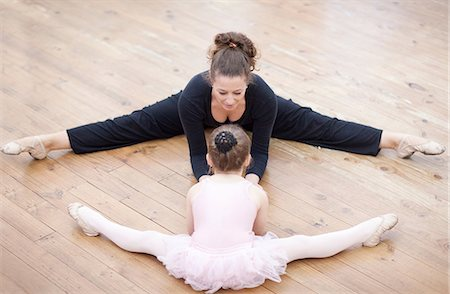 Teacher and young ballerina practicing stretch Stock Photo - Premium Royalty-Free, Code: 649-07063700
