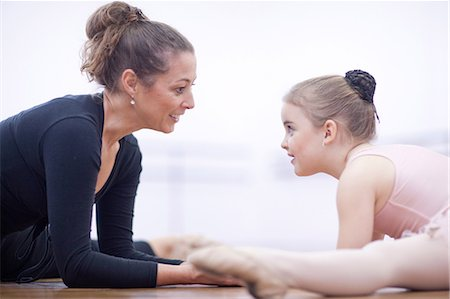 Teacher and young ballerina practicing floor stretch Stock Photo - Premium Royalty-Free, Code: 649-07063701