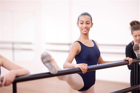 Teenage ballerina practicing at the barre Stock Photo - Premium Royalty-Free, Code: 649-07063717