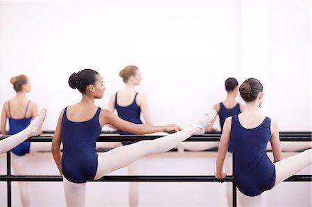 Group of teenage ballerinas practicing at the barre Stock Photo - Premium Royalty-Free, Code: 649-07063718