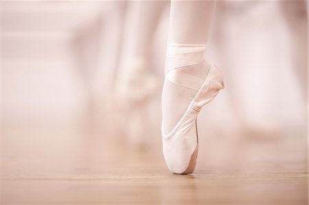 female feet close up - Detail of ballerinas legs in dance studio Stock Photo - Premium Royalty-Free, Code: 649-07063729