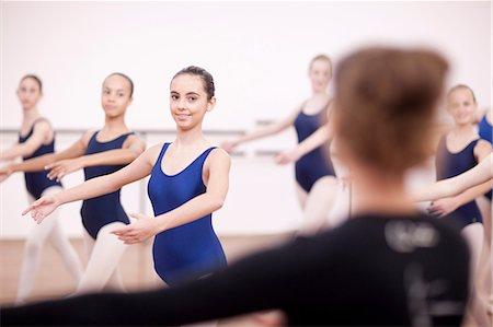 Teacher in front of teenage ballerinas Stock Photo - Premium Royalty-Free, Code: 649-07063723