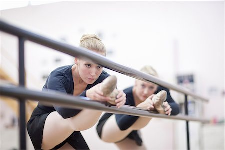 Female ballerinas practicing at the barre Stock Photo - Premium Royalty-Free, Code: 649-07063736