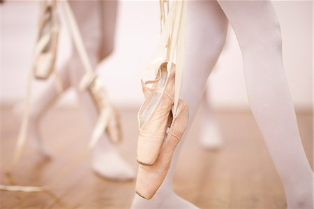 Detail of ballerinas legs leaving dance studio Stock Photo - Premium Royalty-Free, Code: 649-07063730