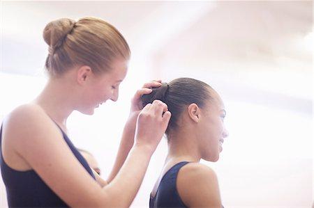 Teenage ballerina helping friend with hair Stock Photo - Premium Royalty-Free, Code: 649-07063731