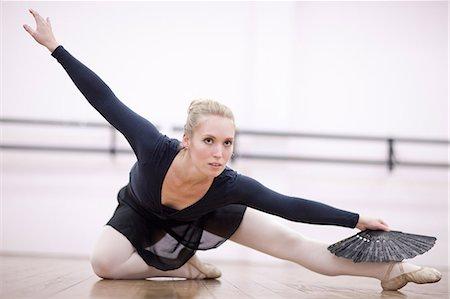 Female ballerina practicing on the floor Stock Photo - Premium Royalty-Free, Code: 649-07063740