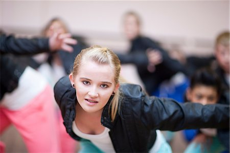 Teenagers practicing hip hop dance in studio Stock Photo - Premium Royalty-Free, Code: 649-07063756