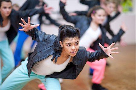 preteen dancing - Group of teenagers dancing in studio Stock Photo - Premium Royalty-Free, Code: 649-07063751