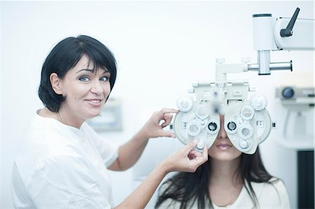 Young woman having eyes tested Stock Photo - Premium Royalty-Free, Code: 649-07063764