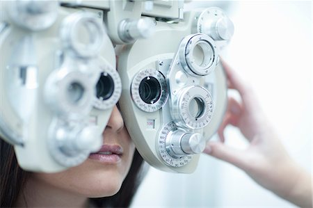 Young woman having eye test Stock Photo - Premium Royalty-Free, Code: 649-07063763