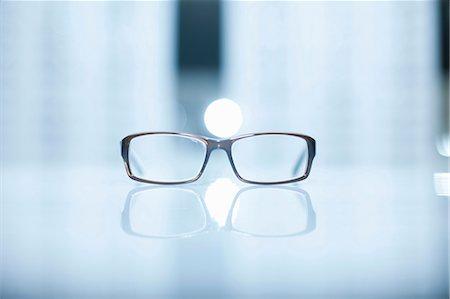 pair - A pair of lone eyeglasses Stock Photo - Premium Royalty-Free, Code: 649-07063805