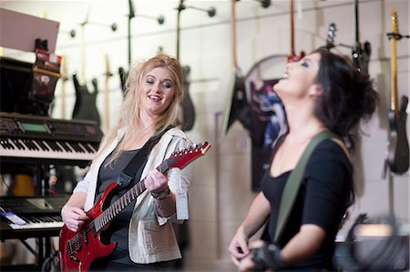 Two young women trying electric guitars in music store Stock Photo - Premium Royalty-Free, Code: 649-07063812