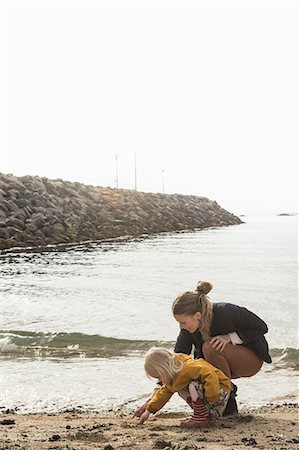Mother and toddler exploring shoreline Stock Photo - Premium Royalty-Free, Code: 649-07063824