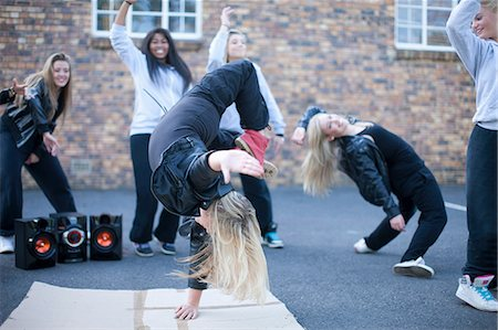 Blond girl breakdancing in playground Stock Photo - Premium Royalty-Free, Code: 649-07063838