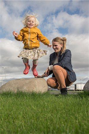 Toddler jumping off rock Stock Photo - Premium Royalty-Free, Code: 649-07063830