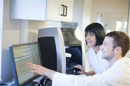 dentistry - Dental technicians using computer to operate dental equipment Stock Photo - Premium Royalty-Free, Code: 649-07063850