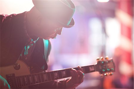 Close up mature man playing guitar on stage Stock Photo - Premium Royalty-Free, Code: 649-07063890