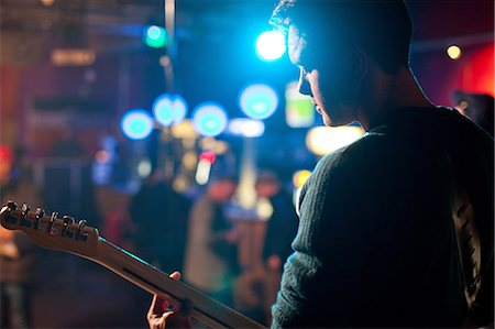 Man on stage playing guitar in nightclub Stock Photo - Premium Royalty-Free, Code: 649-07063900