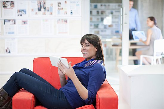 Woman waiting outside office Stock Photo - Premium Royalty-Free, Image code: 649-07063920