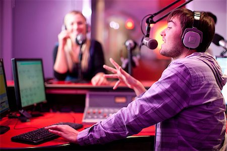 purple - Young man and woman broadcasting in recording studio Stock Photo - Premium Royalty-Free, Code: 649-07063935