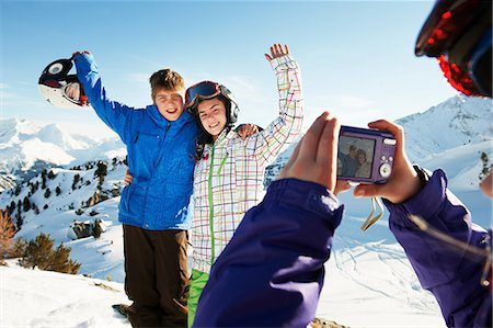 Girl photographing siblings, Les Arcs, Haute-Savoie, France Stock Photo - Premium Royalty-Free, Code: 649-07118124