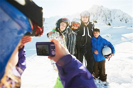 Girl photographing family, Les Arcs, Haute-Savoie, France Stock Photo - Premium Royalty-Free, Code: 649-07118125