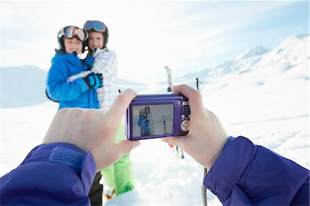 Sister photographing siblings in snow, Les Arcs, Haute-Savoie, France Stock Photo - Premium Royalty-Free, Code: 649-07118137
