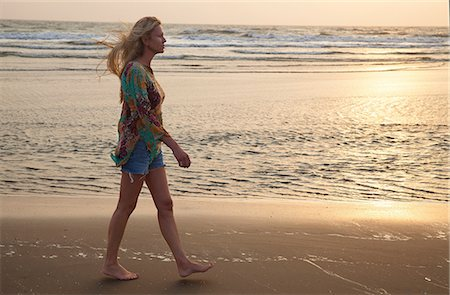 Woman walking on beach Stock Photo - Premium Royalty-Free, Code: 649-07118144