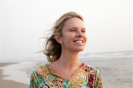 Woman smiling enjoying sea breeze Stock Photo - Premium Royalty-Free, Code: 649-07118146
